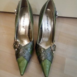 Green pointy high heeled shoes.